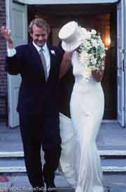 A bride and groom leaving church; Size=180 pixels wide